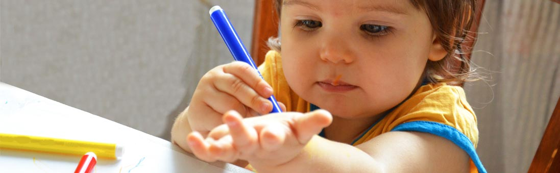Baby holding a pen
