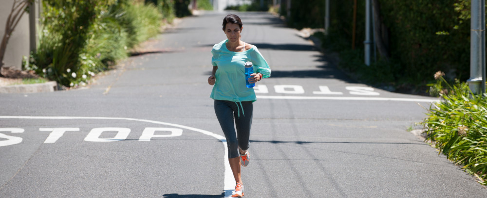 Woman jogging, enjoying her new hobby