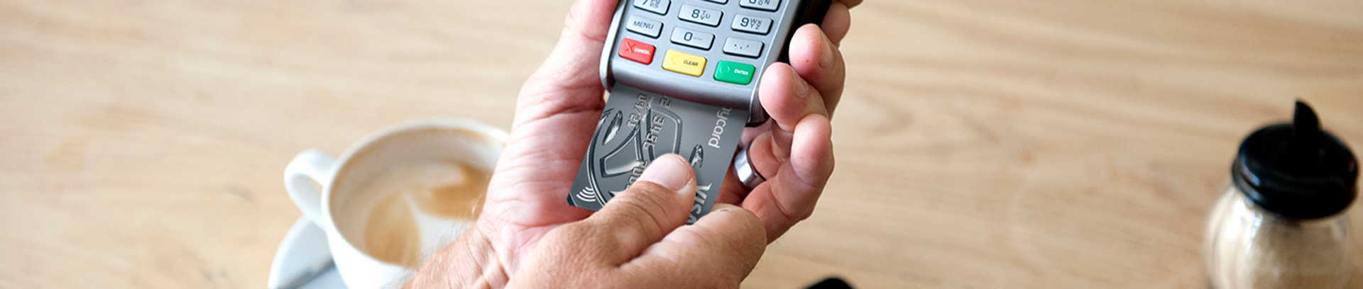 Credit card being inserted into a chip and pin machine