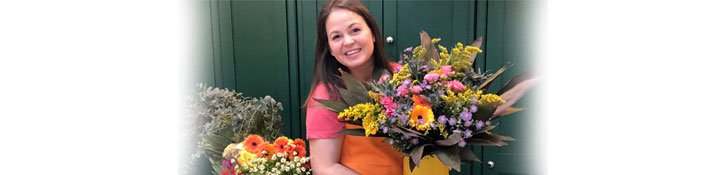 Giovanna holding a large bunch of flowers