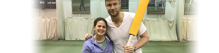 Giovanna and Freddie Flintoff. Freddie Flintoff is holding a cricket bat