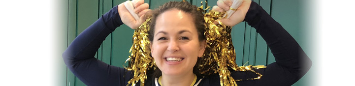 Giovanna with gold tinsel cheerleading pom poms